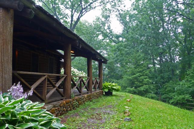 log cabin porch in rain